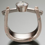 Curved Beam Setting, with .75 Carat Diamond
